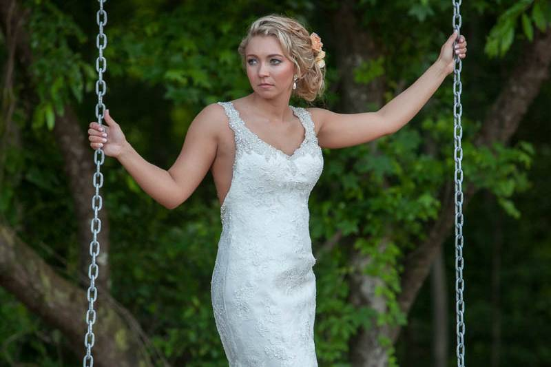 Bride riding the swing