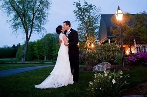 Newlyweds kissing outdoors