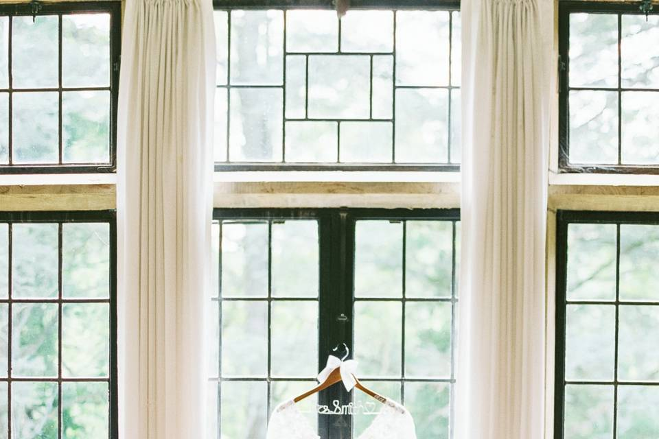 The dress hanging in a window