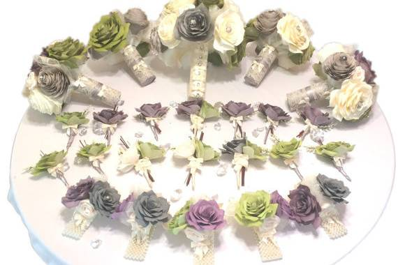 Wedding party package shown in plum, olive green and grey but can be made in colors of your choice. Flowers have a pearl and rhinestone center. There is lace, tulle and pearl sprays surrounding the flowers with satin ivory ribbon and lace around the handles.