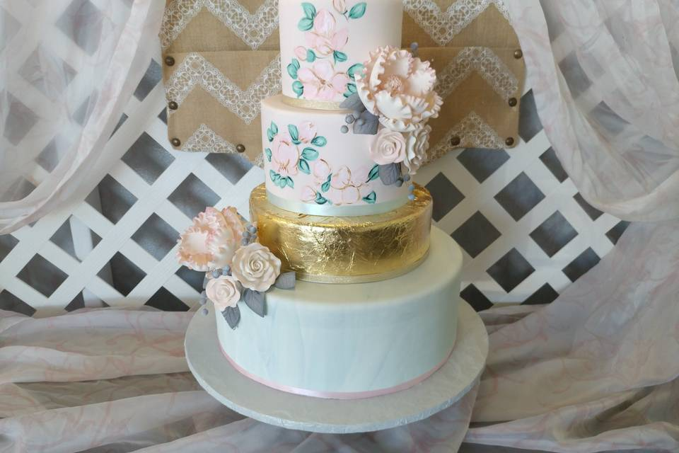 Watercolour-marbled fondant, edible gold leaf, bold peonies, painted florals.