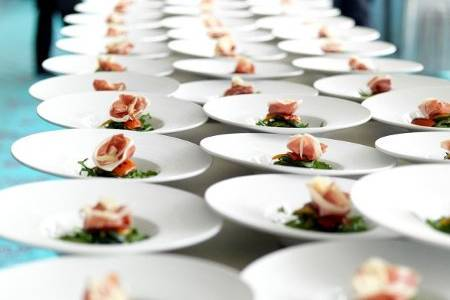 Parma Ham with baby aragula, caramelized macademia nuts, balsamic reduction, raspberry champagne vinaigrette, for 500 guests.