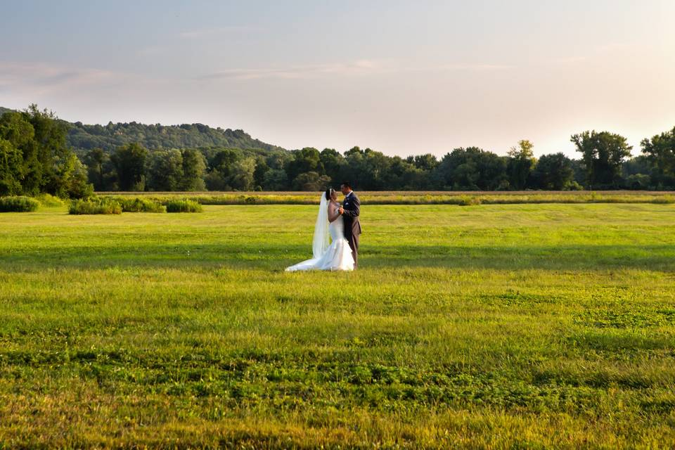 Couple standing in the great outdoors - Kindred Photography