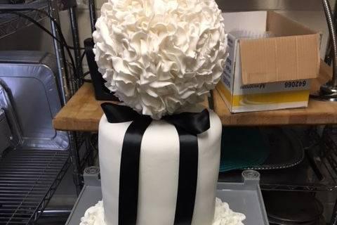Four tier wedding cake with black ribbon