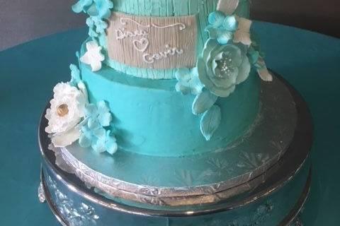 Three tier white and blue cake