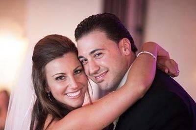 Newlyweds pose for a photo