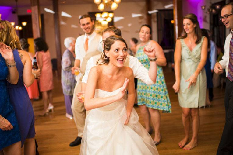 Newlywed dancing with guests
