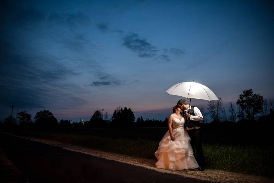 Couple under Umbrella at Night