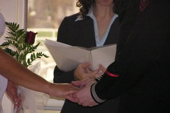 Couples often hold hands during the vows.