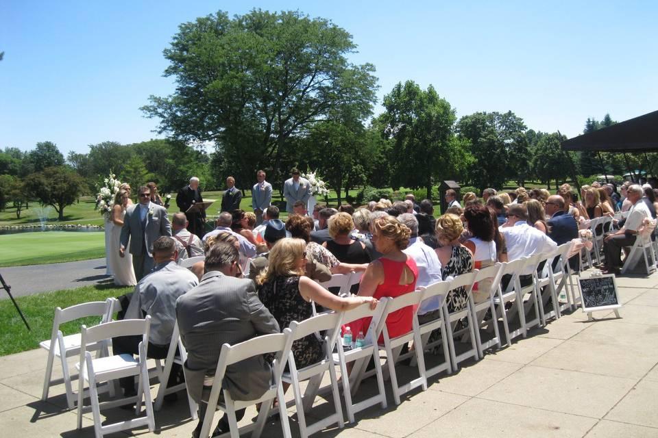 Enjoying a wedding ceremony outside