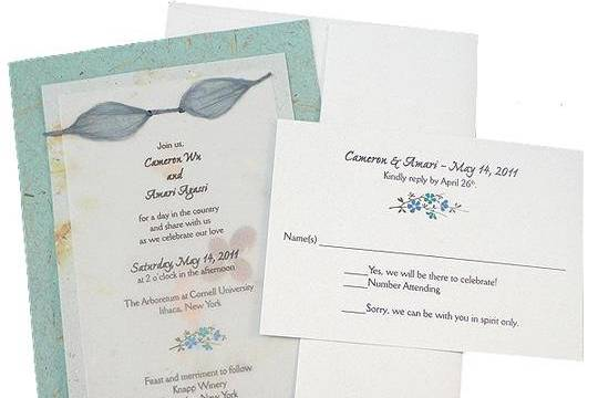 100% recycled handmade double panel wedding invitation and RSVP card with eco-twist bow on periwinkle and bluegrass paper. Custom calligraphy services, plantable seed paper and DIY Kit available!