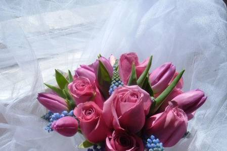 Beautiful hand tied bouquet of fresh lavender roses