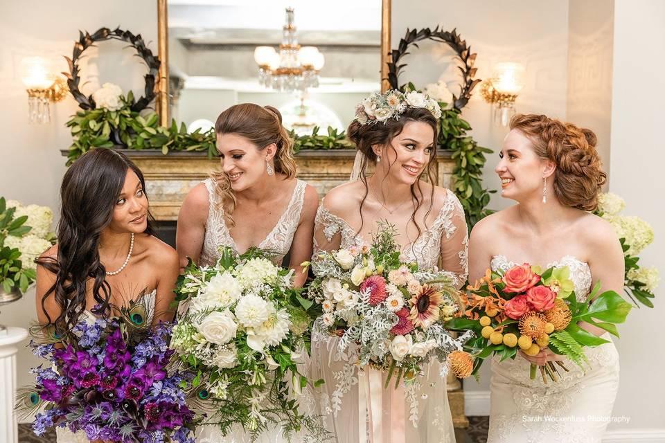 Brides in ballroom.