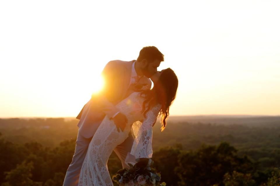 Kurtis & Roni kiss as the sun sets