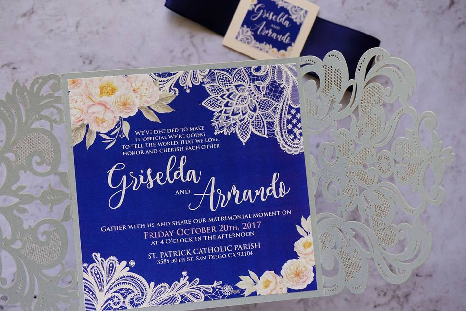 Lace and watercolor invitation in navy blue and silver with a laser cut enclosure