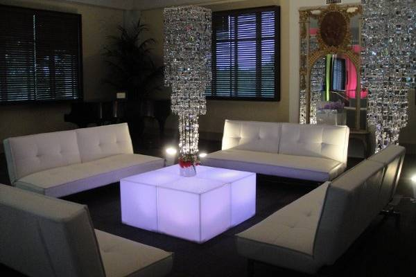 Modern lounge area. Leather sofa's, lighted tables and shimmery chandi's.