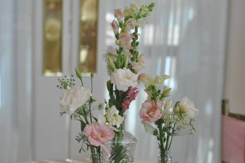 Misc. bud vases centerpiece