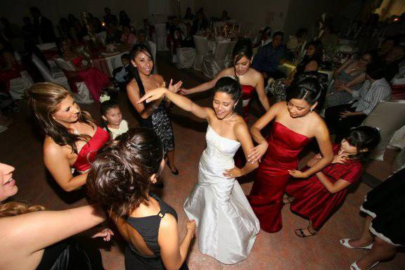 Brides dancing with guests