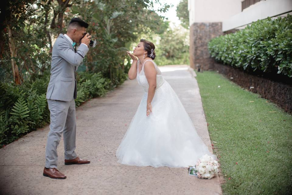 The groom taking photo of the bride