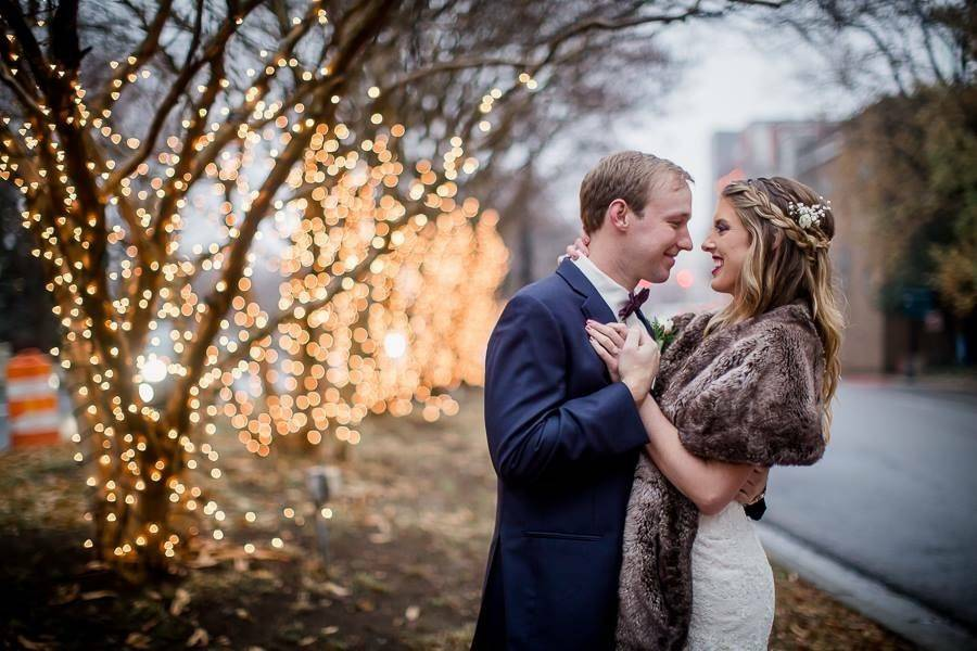 Newlyweds by the tree lights