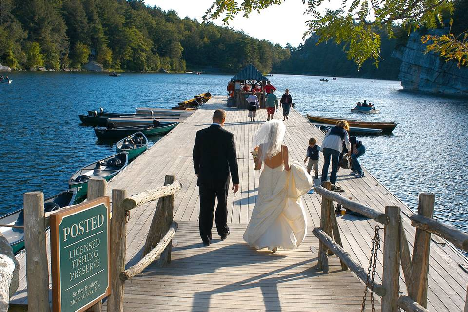 Bride and groom on boat dock
