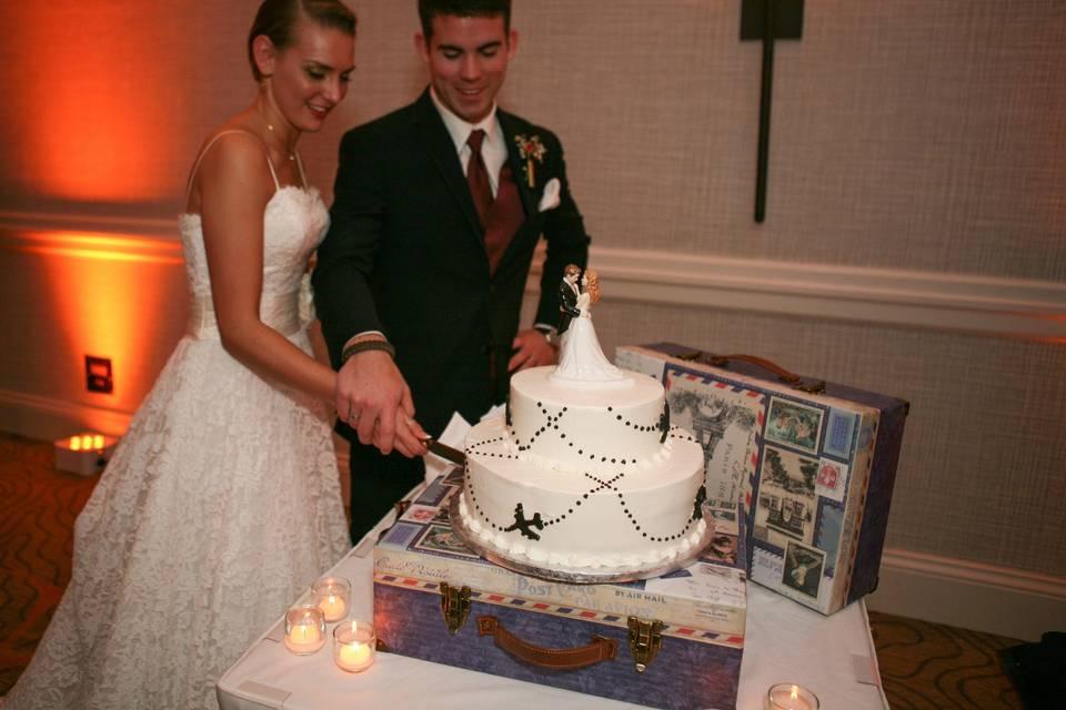 Couple with the wedding cake