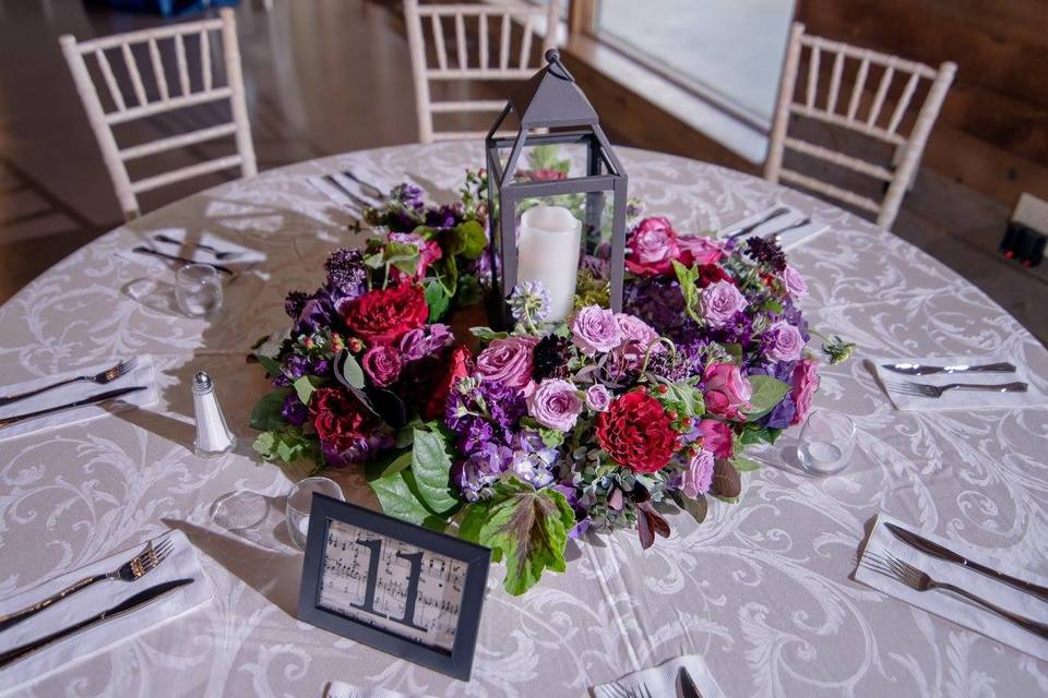 Lantern centerpiece with music themed table numbers