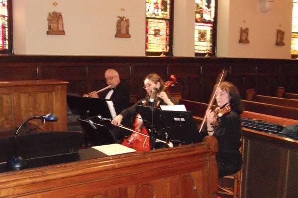Trio performance in a church