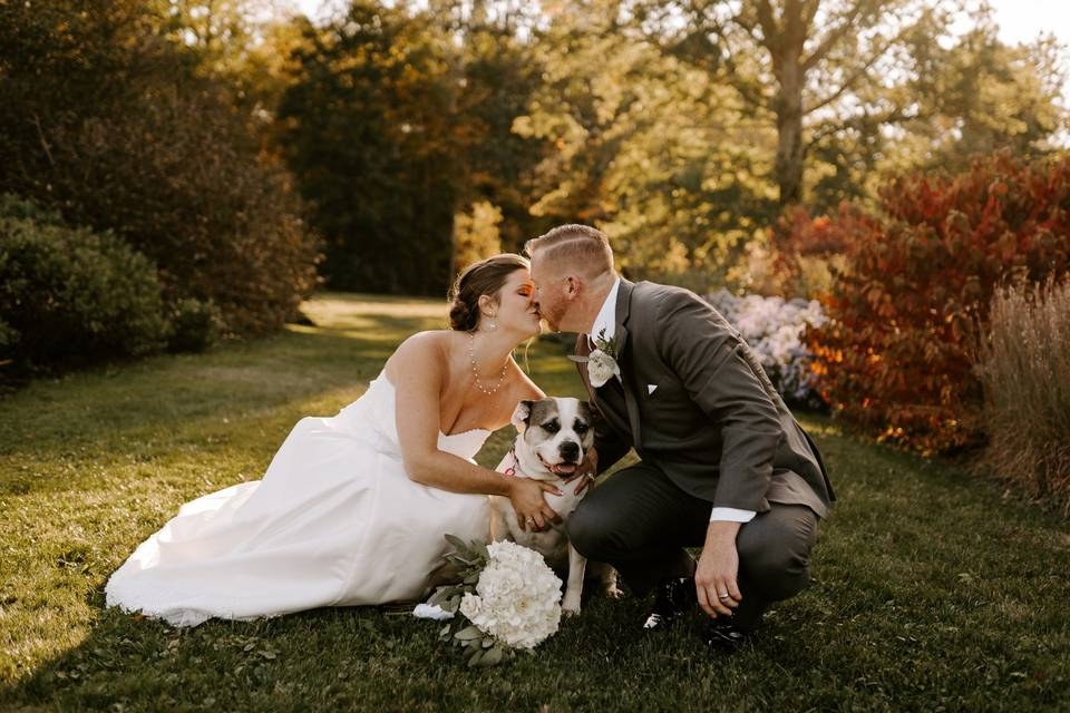 Couple posing with dog