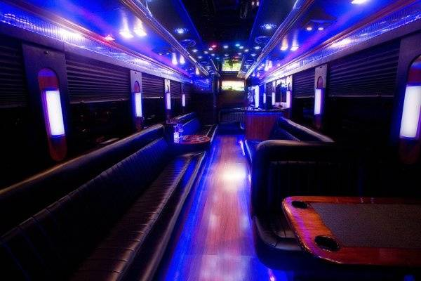 30 passenger Limo Liner interior.  Stand up bar is on the right and restroom is in the back on the left.