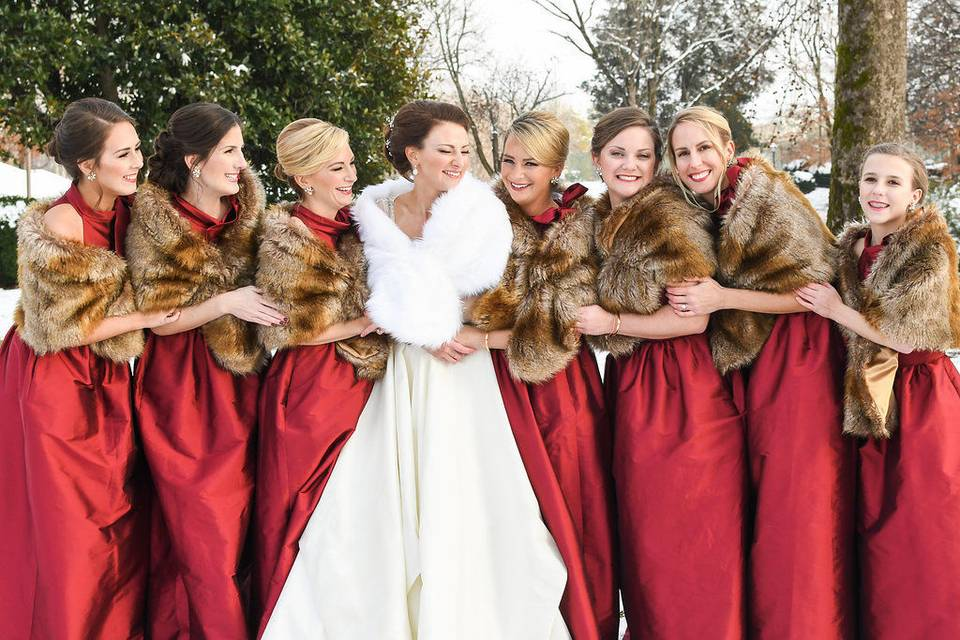Bride and bridesmaids with their coats