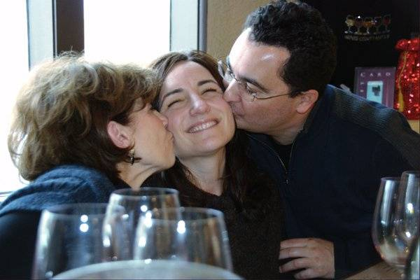 Groom and Mother of Bride wine tasting and smooching Bride to be...