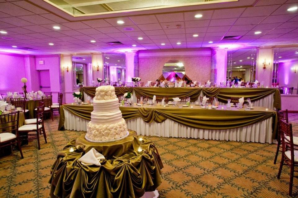 Head table and wedding cake display