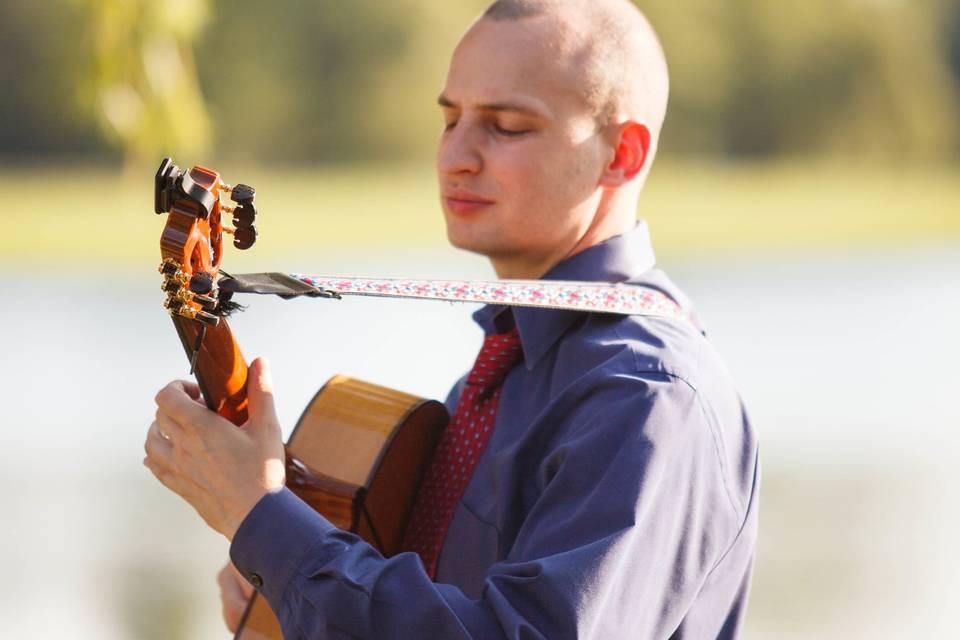 Jim Perona on his guitar