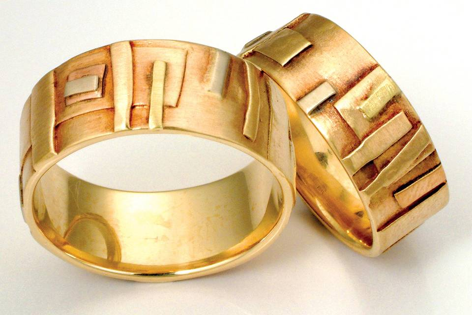 The Echo Band. 14k and 18k gold custom handmade wedding bands available in yellow or white gold, with colored gold accents.