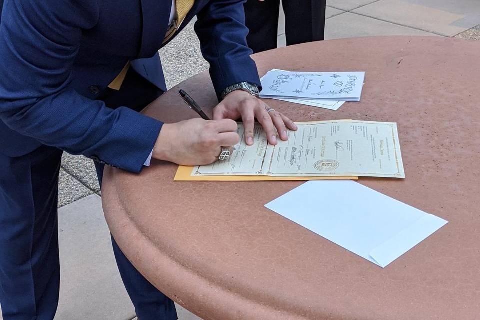 Mario Signing Marriage License