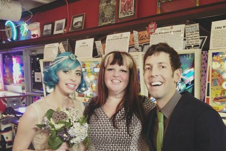 Happy couple with the officiant