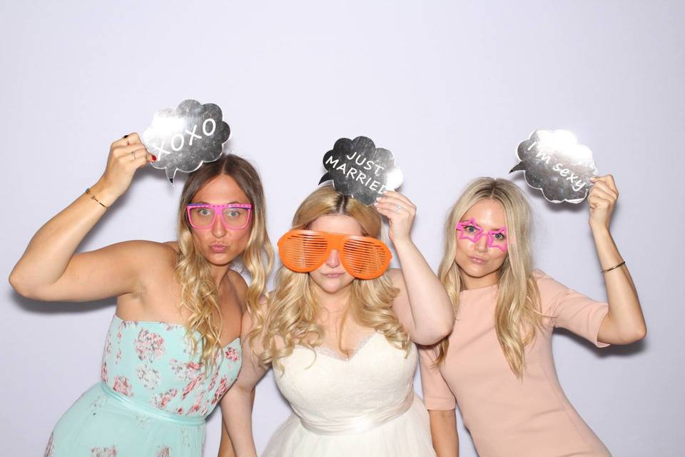 Bride and bridesmaids in the booth