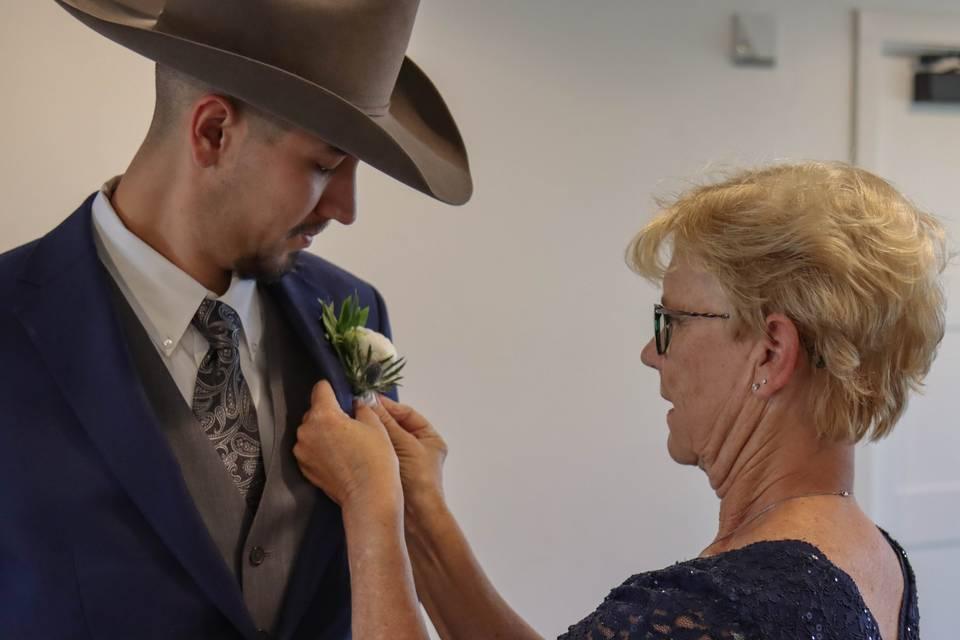 Grandma pinning the groom