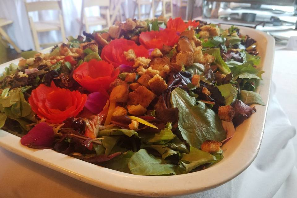 Fresh salad topped with florals