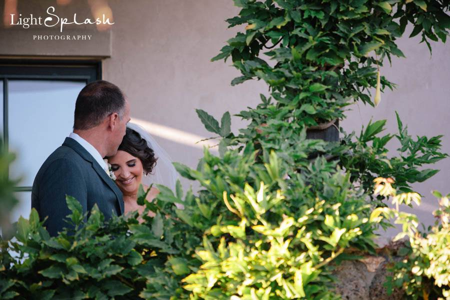 The father of the bride and bride sharing a quiet moment before they walk down the aisle.