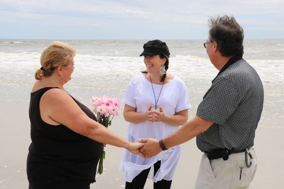 Super casual, fun ceremony with friends and family on the beach.