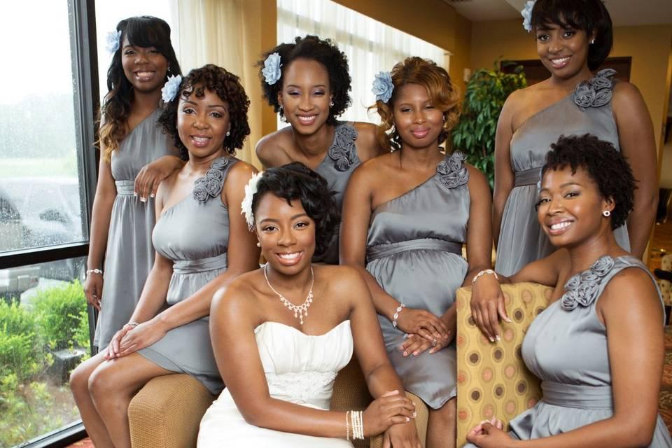 Bridesmaids pose with bride