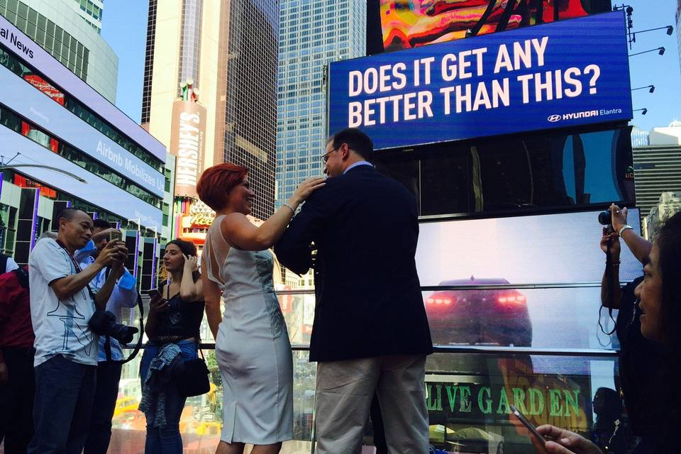 Couple by a sign