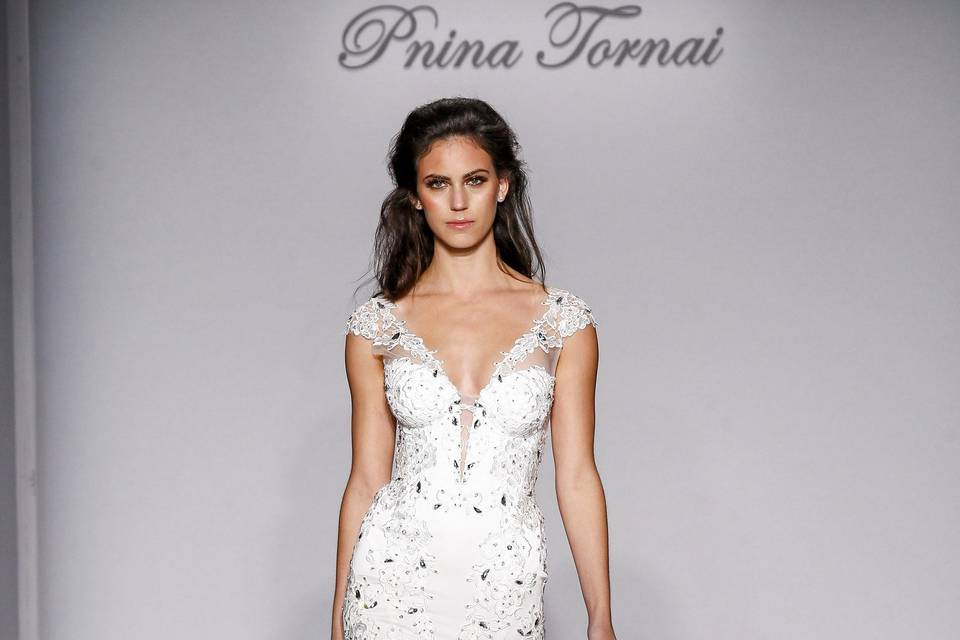 Pnina Tornai Style 4455  Ivory satin and tulle mermaid with Guipure lace appliques, lace straps embroidered with Swarovski crystals, and illusion back.