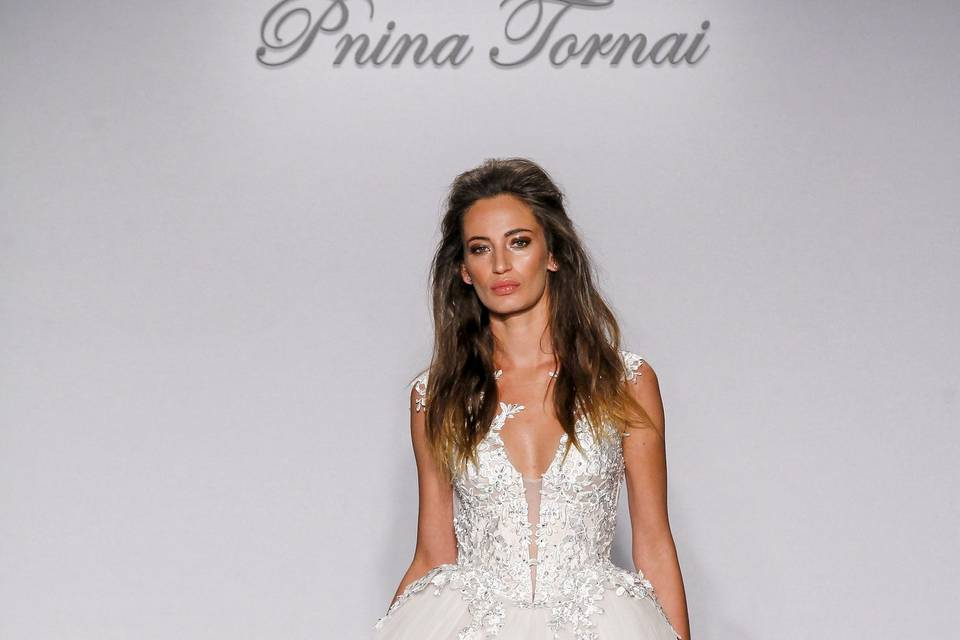 Pnina Tornai Style 4452  Ivory tulle and Guipture lace ball gown with Swarovski beaded and pearl bodice with corset back.