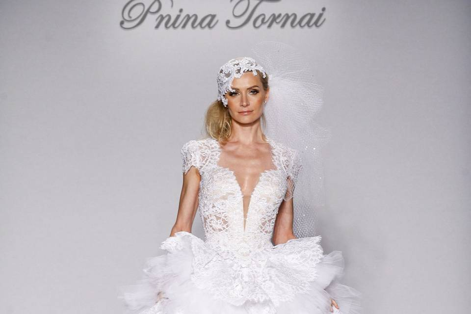 Pnina Tornai Style 4465 Ivory corded lace two-piece  ball gown with water crystal embroidered short sleeve bodice and keyhole back with tiered ruffled lace and tulle skirt.