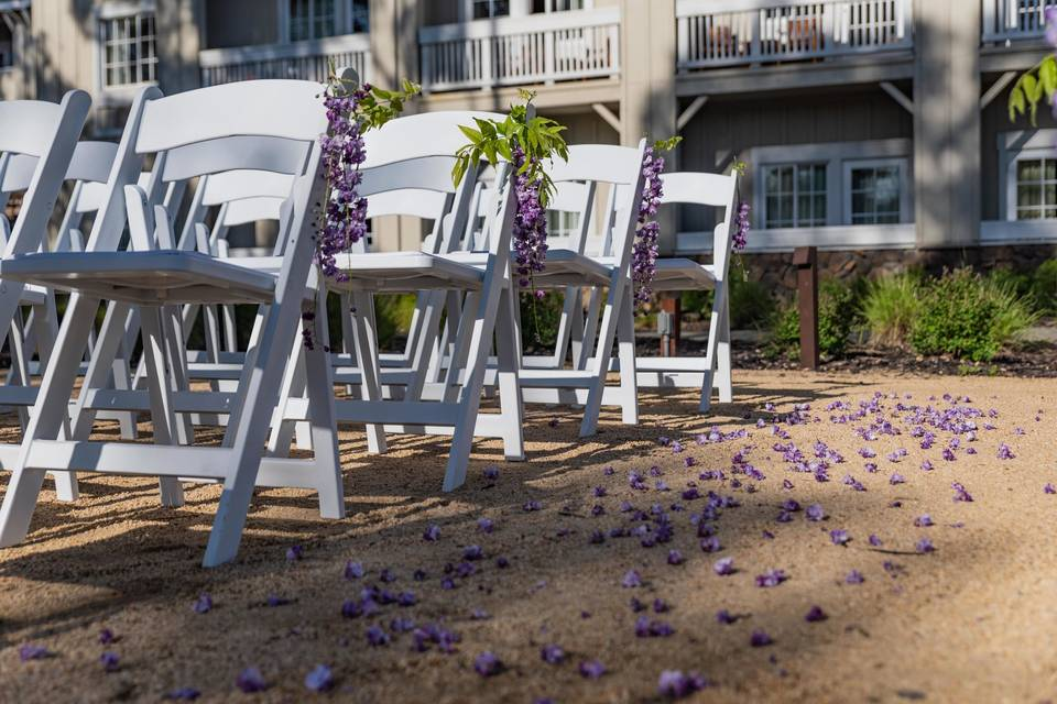River Walk Clearing White Chairs