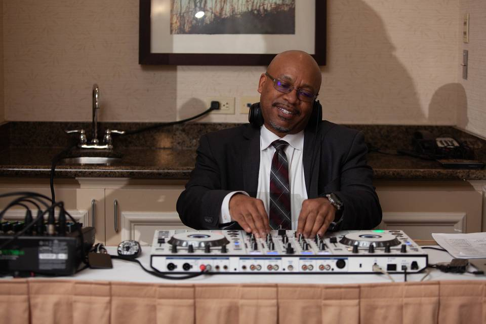 DJ working a mix transition
