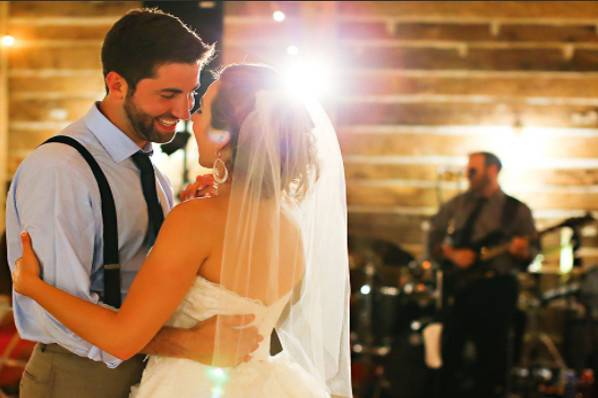 Newlyweds dancing to the band's music
